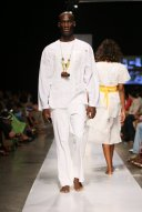 2008 - 2009 Runway Collection. Cotton tsh5 tunic 21 years old design mono chrome white. Regal enough for a wedding, his perhaps, an intimate kind of affair on the sands somewhere. Classic Cloth tunic in monochromatic white paired with white, flat-front, boot-cut That Pants.