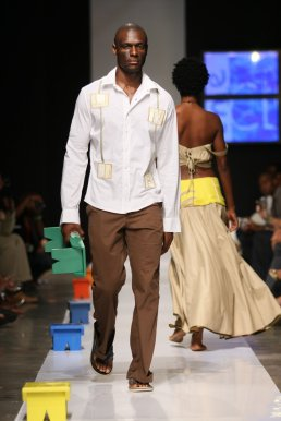 2008 - 2009 Runway Collection. Small man shirt. Daring with limits. Fitted classic structured white shirt with twin appliques paired with flat-front brown boot-cut That Pants.
