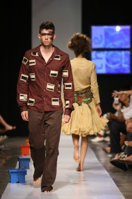 2008 - 2009 Runway Collection. Small man pants That man pants. Daring with limits. Fitted classic structured brown shirt with earth toned applique paired with brown flat-front, boot-cut That Pants.