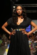2008 - 2009 Runway Collection. Inspired by life and its rhythms. Empire waist with v-neck and bat sleeves.